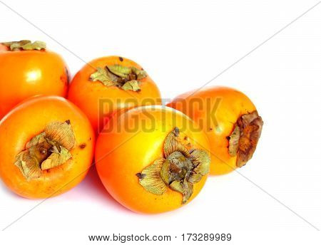 Still life with five ripe big persimmons isolated studio shot front view closeup