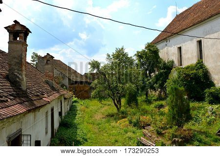 Courtyard of the fortified medieval saxon church in Ungra, a commune in Braşov County, Romania. Here there is a medieval 13th century Transylvanian Saxon church and many old houses
