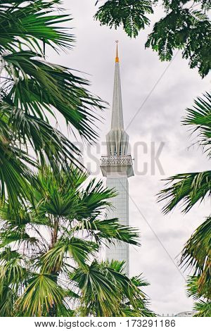 The minaret that towers above the National Mosque Masjid Negara in Kuala Lumpur, Malaysia. Selective focus on the tower.