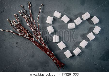 Candy top view flat lay pattern marshmallow on dark background. Candy isolated minimal concept food background.