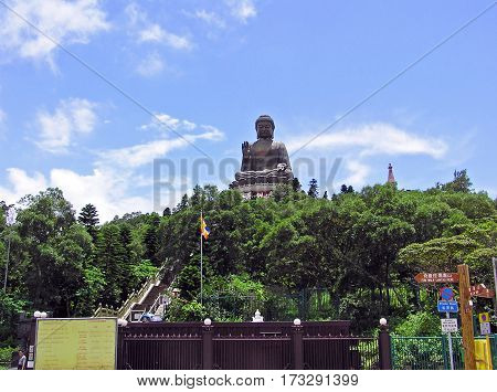 Lantau, Hong Kong - March 24, 2003: People visit the giant Tian Tan Buddha in Lantau, Hong Kong.