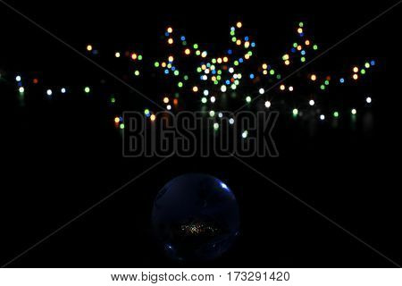 globe with the contour of the ground on a background of colored lights
