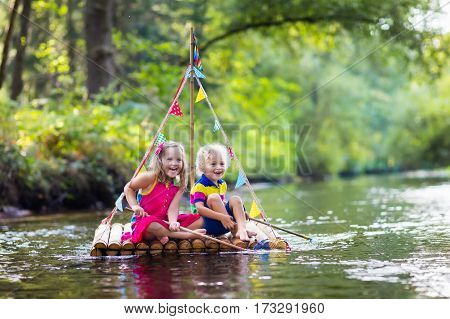 Kids On Wooden Raft