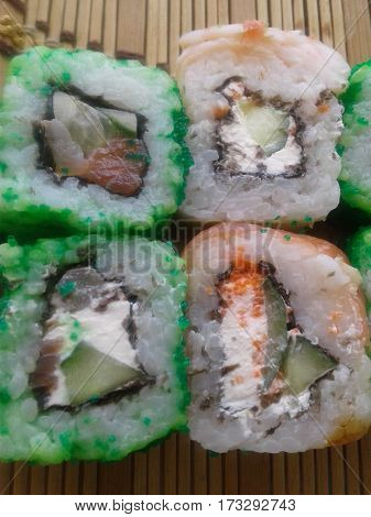 Sushi - a fashionable, healthy and tasty food that has become very popular traditional dish in Japanese cuisine. It is prepared with rice and seafood dish is the ancient Japanese green flying fish cream - cheese cheese