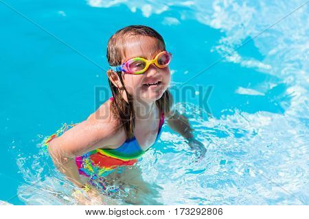 Child Learning To Swim In Pool