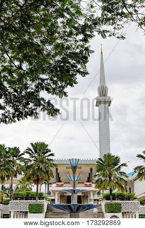 Kuala Lumpur, Malaysia - February 7, 2016: The minaret that towers above the National Mosque Masjid Negara in Kuala Lumpur, Malaysia.