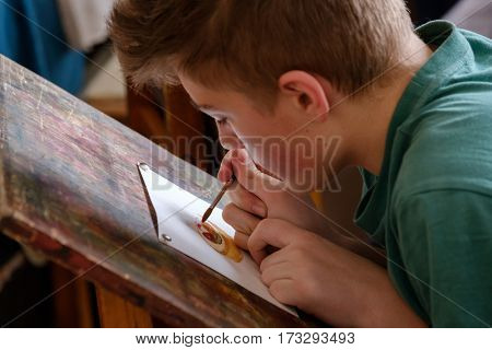 Moscow, Russia - February 18, 2017: Teen aged 10-14 years attends free drawing workshop during the open day in watercolors school