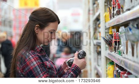 woman buys spice in supermarket or store