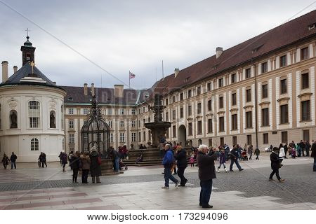PRAGUE CZECH REPUBLIC - NOVEMBER 3 2012: In the courtyard of Prague Castle is always a lot of tourists