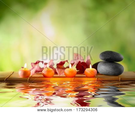 Beautiful spa composition with reflection on water surface