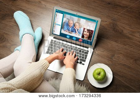 Video call and chat concept. Woman video conferencing on laptop