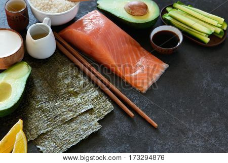 Ingredients for the preparation of rolls and sushi on a black background. food background