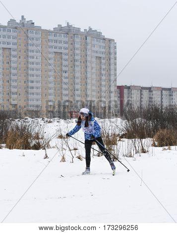 Kirishi, Russia - 11 February, The young girl on skis, 11 February, 2017. Mass ski race Russian Ski Track.
