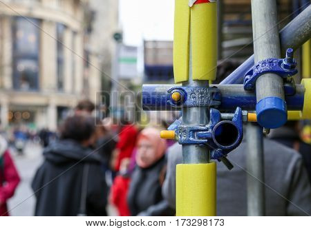 Magdalen street Oxford United Kingdom February 19 2017: Scaffolding with closeup on bolts clamped joints and foam safety protection for pedestrians in Oxford England