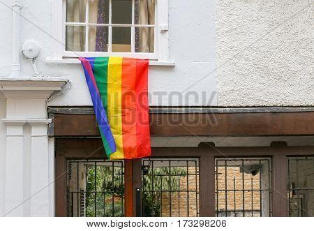 Hollywell street Oxford United Kingdom February 19 2017: Rainbow flag on Holywell street collage white window in Oxford England
