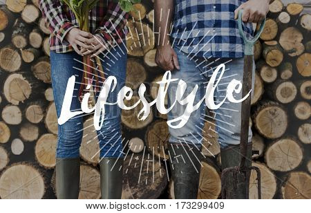 Active Caucasian Farmers on Jeans Firewood