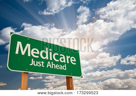 Medicare Green Road Sign Over Dramatic Clouds and Sky.