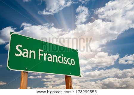 San Francisco Green Road Sign Over Dramatic Clouds and Sky.