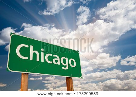Chicago Green Road Sign Over Dramatic Clouds and Sky.