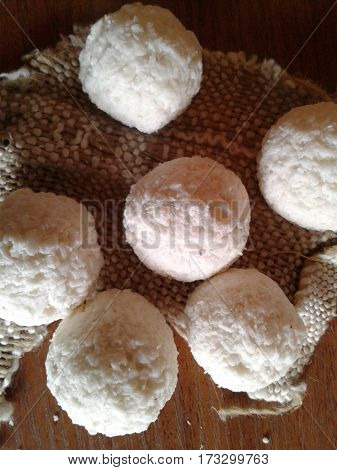 Candy - the products that are produced from sugar with the addition of various ingredients pastry round small white background sweet dessert food