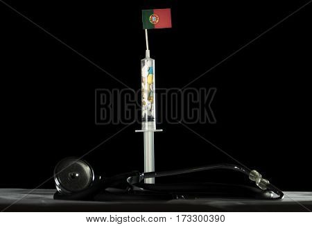 Stethoscope And Syringe Filled With Drugs Injecting The Portuguese Flag On A Black Background