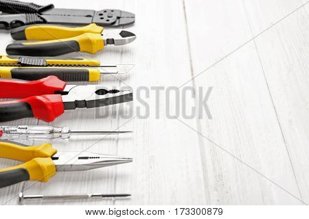 Different electrical tools on wooden table