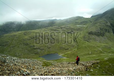 Lonely walker descending from Great Gable to Styhead Tarn