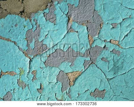 The texture of a wall with the cracked blue paint