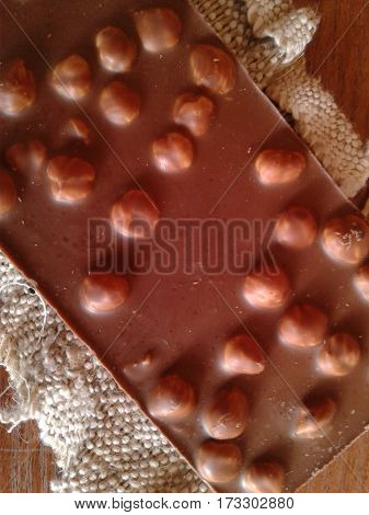 Chocolate - a confection based on cocoa butter, which is the product of processing cocoa beans - the seeds of the tree of chocolate, caffeine goals hazelnuts sweet dessert cocoa