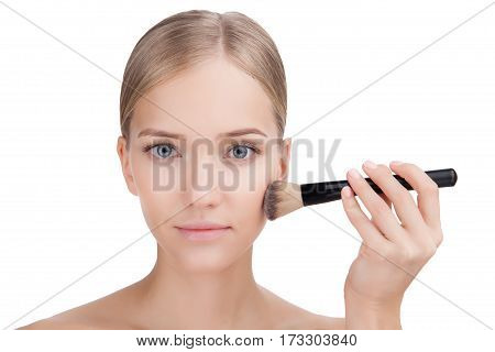 Beauty Woman face Portrait with make up brush. Beautiful Blonde Spa model Girl with Perfect Fresh Clean Skin. Skin Care Concept Isolated on a white background