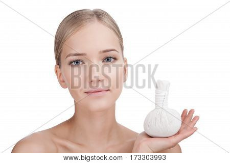 Beauty Woman face Portrait with herbal bag in her hand. Beautiful Blonde Spa model Girl with Perfect Fresh Clean Skin. Skin Care Concept Isolated on a white background