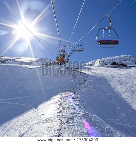 Chairlift Going Up Of The Mountains In A Sunny Day In Pyrenees, Spain