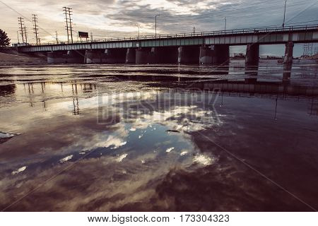 Viaduct from Los Angeles River with a Bridge at sunset time and cloud sky
