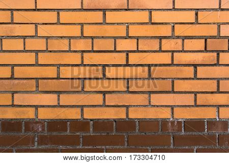 Red and brown brick wall with horizontal masonry. Background