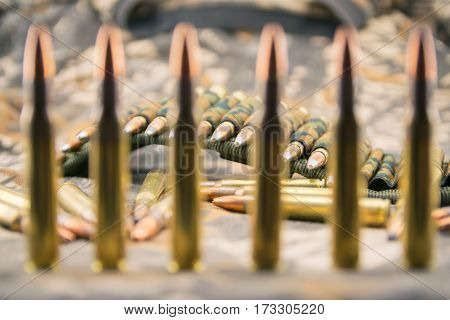Hollow point ammunitions for rifle on camouflage background.