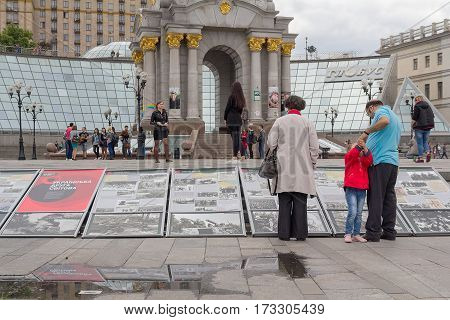 Kiev Ukraine - May 21 2016: Citizens at the Independence Square familiarize with visual agitation of the Second World War in Ukraine