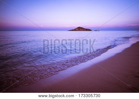 Su Giudeu island at sunset Chia Sardinia Italy.
