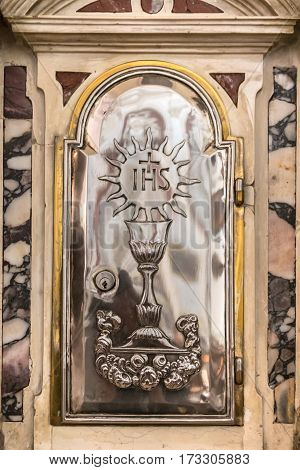Verona, Italy - May 12, 2016: Detail of a tabernacle in a Catholic church in which are preserved the consecrated hosts after the Eucharistic celebration.