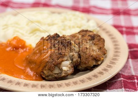 Meatballs With Tomato Sauce On The Plate