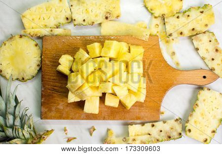 Pineapple Fruit Slices On A Kitchen Board