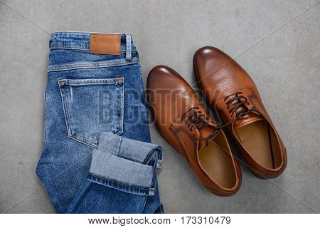 Set of mans with jeans and shoes on gray background