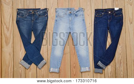 Three three different Jeans and wooden board