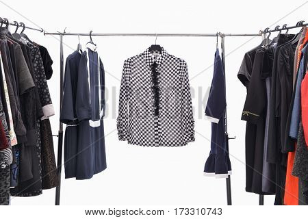 Variety of casual female clothing on hangers