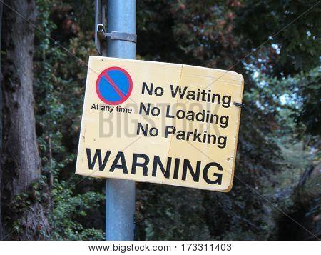 No Waiting No Loading No Parking Sign