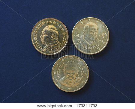 50 euro cents coins (EUR) from Vatican City bearing the portrait of pope John Paul II (Karol Josef Woytila) Benedict XVI (Joseph Ratzinger) and Francis I (Jorge Mario Bergoglio)