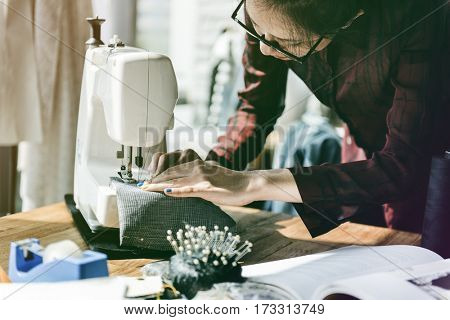 Fashion designer tailor made with sewing machine