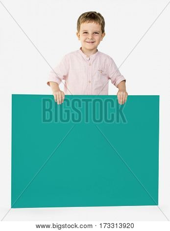 Little Boy Holding Empty Paper Smiling