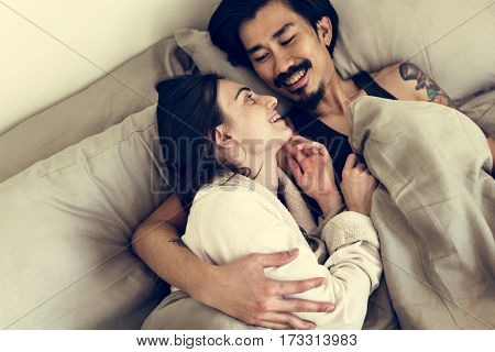 Couple is together in a house.