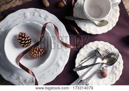 Set of dinnerware on wooden table
