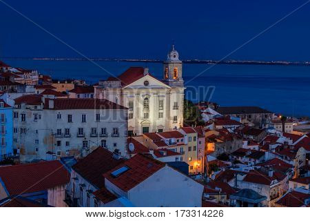 View of Alfama at dusk in Lisbon Portugal